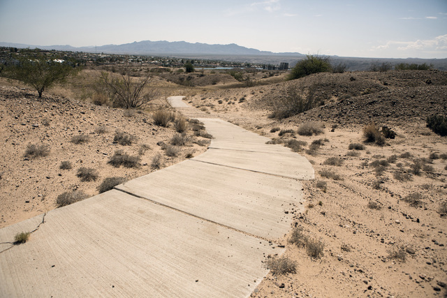 A cart trail on a closed golf course is seen Thursday, July 28, 2016, on the southern end of Laughlin, Nev. Jeff Scheid/Las Vegas Review-Journal Follow @jeffscheid