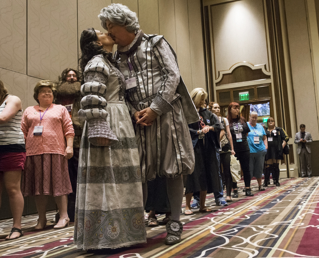 """Carolyn and Mike Dufano, dressed as """"The Grey Lady"""" and """"Nearly Headless Nick,"""" share a kiss during LeviosaCon, a Harry Potter convention, on Friday, July 8, 2016, at Green Valley Ranch in Henders ..."""
