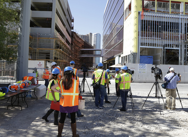 Members of the media wait outside the under-construction Lucky Dragon hotel-casino prior to the start of the hard hat tour at 300 W. Sahara Ave., on Thursday, July 7, 2016. Bizuayehu Tesfaye/Las V ...