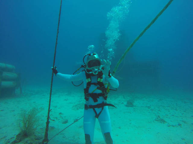 NEEMO 18 crew member ESA (European Space Agency) astronaut Thomas Pesquet wraps up rehearsals and training in his dive helmet off the coast of Key Largo, Florida, July 2014. Courtesy NASA
