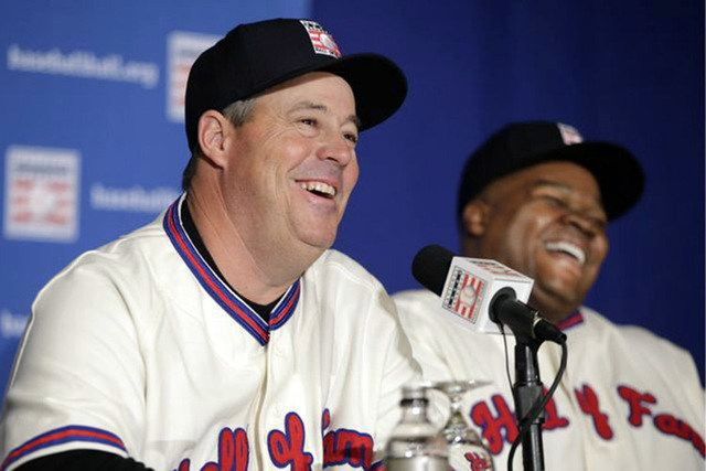 Former Atlanta Braves pitcher Greg Maddux, left, and former Chicago White Sox slugger Frank Thomas laugh during a press conference announcing their election into the 2014 Baseball Hall of Fame cla ...