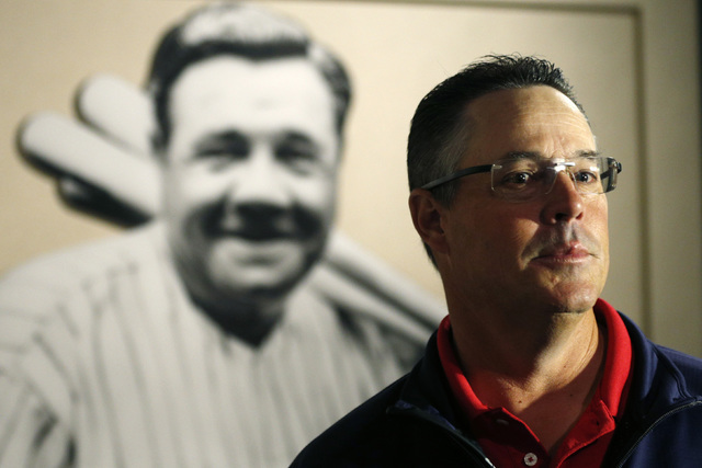 Former Atlanta Braves pitcher Greg Maddux visits a Babe Ruth exhibit during his orientation visit at the Baseball Hall of Fame on Monday, March 24, 2014, in Cooperstown, N.Y. Maddux will be induct ...