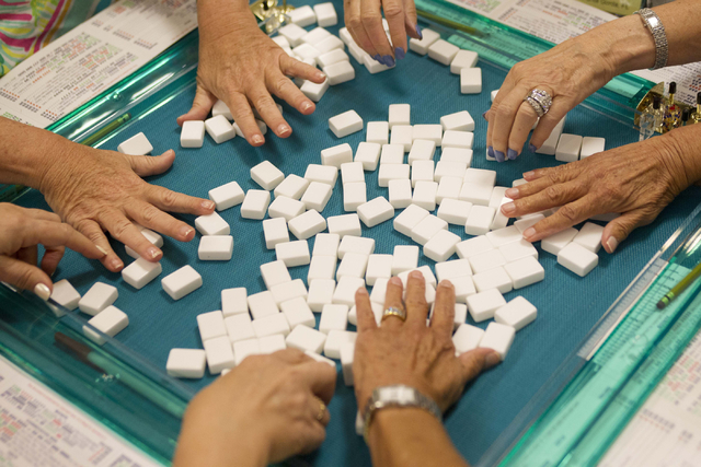 Players mix up mahjong tiles before beginning a new game during the Mah Jongg World Championship at the Westgate Las Vegas hotel-casino in Las Vegas on Saturday, July 23, 2016. Richard Brian/Las V ...