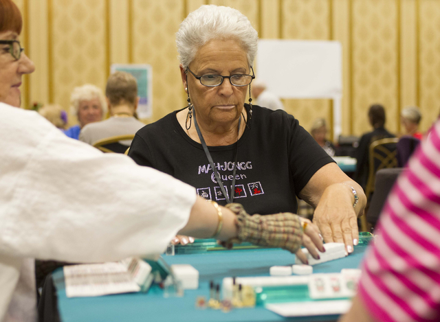 Rita Minnerly of Poughkeepsie, N.Y. plays a mahjong tile while competing during the Mah Jongg World Championship at the Westgate Las Vegas hotel-casino in Las Vegas on Saturday, July 23, 2016. Ric ...