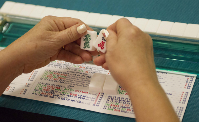 A player looks at her tiles while competing during the Mah Jongg World Championship at the Westgate Las Vegas hotel-casino in Las Vegas on Saturday, July 23, 2016. Richard Brian/Las Vegas Review-J ...