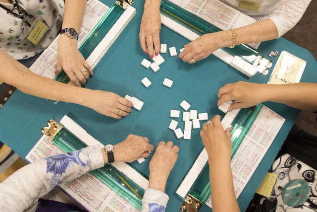 Players add mahjong tiles to their racks before beginning a new game during the Mah Jongg World Championship at the Westgate Las Vegas hotel-casino in Las Vegas on Saturday, July 23, 2016. Richard ...