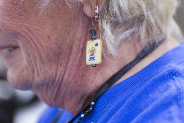 Ruth Hart of Englewood, Fla. wears mahjong tile earrings while competing during the Mah Jongg World Championship at the Westgate Las Vegas hotel-casino in Las Vegas on Saturday, July 23, 2016. Ric ...