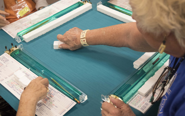 Ruth Hart of Englewood, Fla. plays a mahjong tile while competing during the Mah Jongg World Championship at the Westgate Las Vegas hotel-casino in Las Vegas on Saturday, July 23, 2016. Richard Br ...