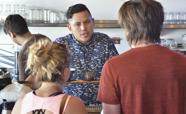 Josh Molina, co-owner of Makers and Finders, center, helps customers at the coffee shop at 1120 S. Main St. in Las Vegas on Wednesday, July 13, 2016. (Bill Hughes/Las Vegas Review-Journal)
