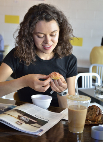 Lizeth Sarabia peels a fig during breakfast at Makers and Finders at 1120 S. Main St. in Las Vegas on Wednesday, July 13, 2016. (Bill Hughes/Las Vegas Review-Journal)