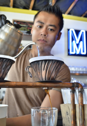 Barista Marwan Agbanlog prepares a cup of coffee at Makers and Finders at 1120 S. Main St. in Las Vegas on Wednesday, July 13, 2016. (Bill Hughes/Las Vegas Review-Journal)