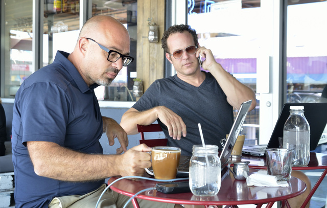 Ryan Nelson, sales director at Converse One, left, and David Peers, senior solutions manager, work on the patio at Makers and Finders at 1120 S. Main St. in Las Vegas on Wednesday, July 13, 2016.  ...