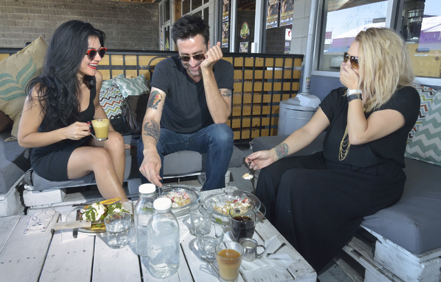 Melody Sweets, left, Robert John Kley and Sarah Redzikowski are shown on the patio at Makers and Finders at 1120 S. Main St. in Las Vegas on Wednesday, July 13, 2016. (Bill Hughes/Las Vegas Review ...