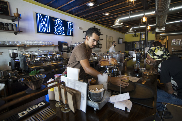 Barista Marco Aguila completes a coffee order at the Makers & Finders coffee shop on Tuesday, July 5, 2016, in Las Vegas. (Erik Verduzco/Las Vegas Review-Journal) Follow @Erik_Verduzco