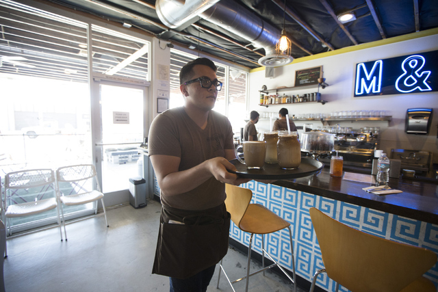 Server Cody Monsalve completes a coffee order at the Makers & Finders coffee shop in Las Vegas on Tuesday, July 5, 2016, in Las Vegas. (Erik Verduzco/Las Vegas Review-Journal) Follow @Erik_Ver ...