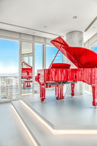 In the main living room is a bright red Pramberger Legacy Series player piano. (Courtesy of Luxury Estates International)