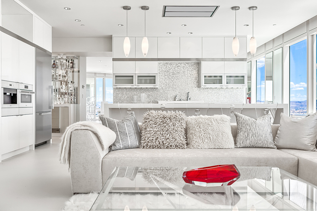 The penthouse is white on white with red accents. (Courtesy of Luxury Estates International)