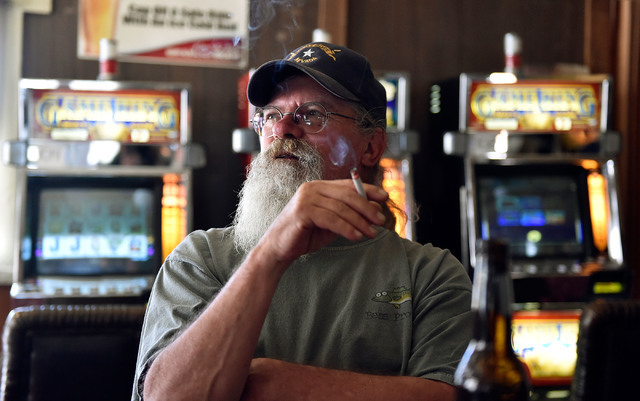 Chicken Dave Sweetwood looks on as he relaxes at the Manhattan Bar Thursday, June 9, 2016, in Manhattan, Nev. The old-time bar has served its customers for decades in the high desert mountain mini ...