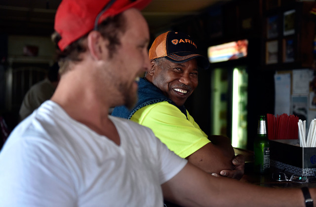 Sam Lauver, left, and David Merritt share a laugh at the Manhattan Bar Thursday, June 9, 2016, in Manhattan, Nev. The historic bar has served its customers for decades in the high desert mountain  ...