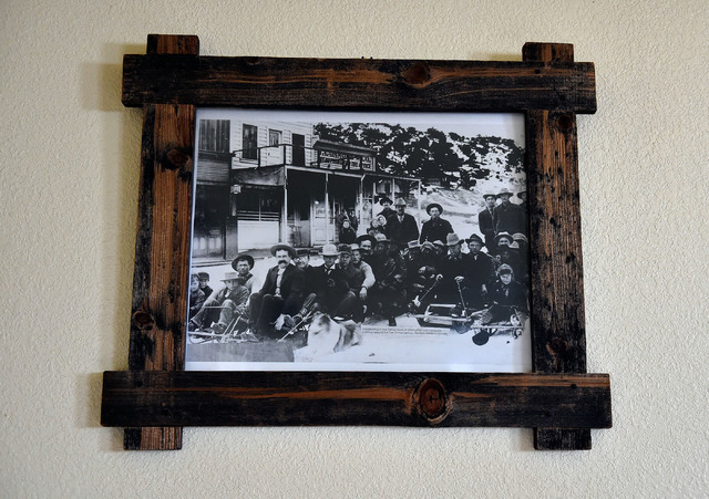 An undated historic photograph of miners on bobsleds is seen hanging on a wall at the Manhattan Bar Thursday, June 9, 2016, in Manhattan, Nev. The old-time bar has served its customers for decades ...