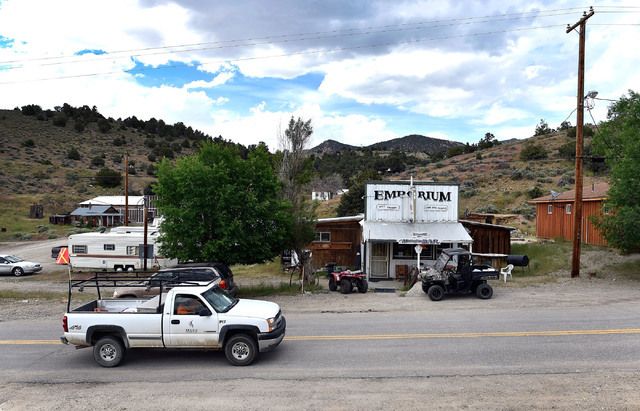 Mine workers are seen arriving at the Manhattan Bar Thursday, June 9, 2016, in Manhattan, Nev. The old-time bar has served its customers, mostly miners, for decades in the high desert mountain min ...