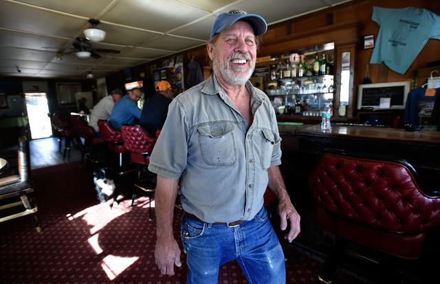 Customer Bill Hudson smiles as he heads out of the Manhattan Bar Thursday, June 9, 2016, in Manhattan, Nev. The old-time bar has served its customers for decades in the high desert mountain mining ...
