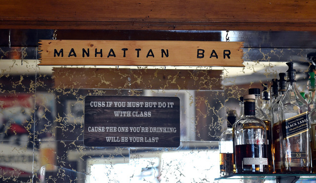 An engraved sign and special rules are seen along top shelf liquor at the Manhattan Bar Thursday, June 9, 2016, in Manhattan, Nev. The old-time bar has served its customers for decades in the high ...