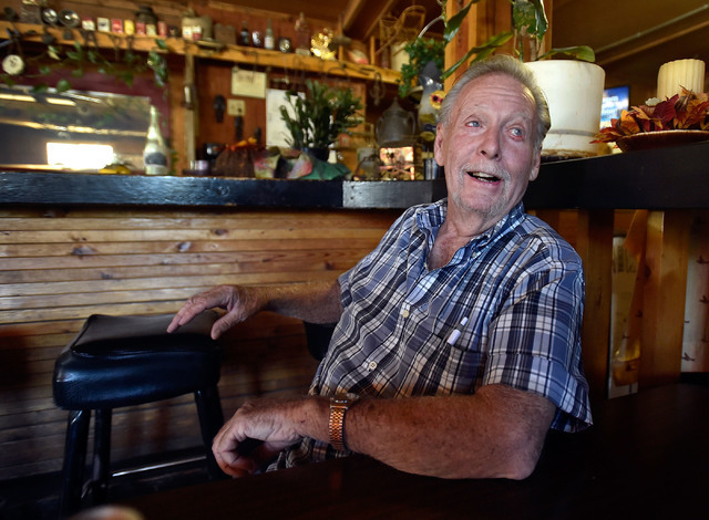 Bobby Bottom relaxes at the Miners Saloon Thursday, June 9, 2016, in Manhattan, Nev. Bottom says a disagreement with a bartender is the reason he doesn't patronize the other bar in town. (David Be ...