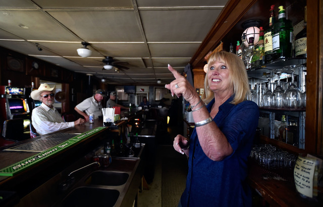 Bartender Sandy Crawford gestures as she speaks with a customer at the Manhattan Bar Thursday, June 9, 2016, in Manhattan, Nev. The old-time bar has served its customers for decades in the high de ...