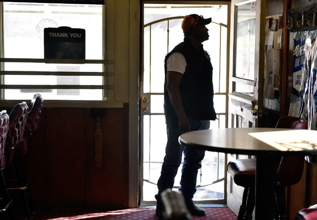 Customer David Merritt  looks over the bulletin board of postings at the Manhattan Bar Thursday, June 9, 2016, in Manhattan, Nev. The old-time bar has served its customers, mostly miners, for deca ...