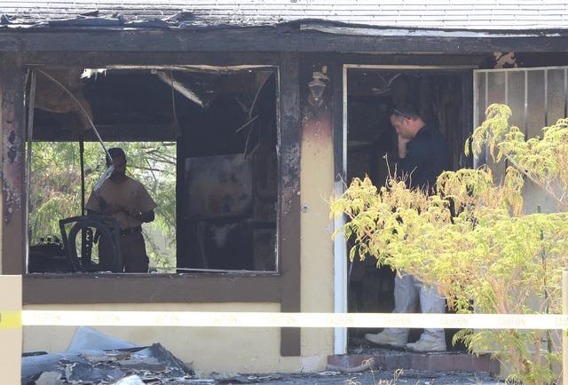 Metro is investigating a house fire at 1009 Marion Drive, near Washington Avenue on Wednesday, July 27, 2016. Bizuayehu Tesfaye/Las Vegas Review-Journal Follow @bizutesfaye