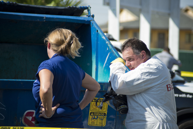 Police and the Southern Nevada Health District investigate a dumpster filled with medical waste at Hampton Court Apartments near Swenson Avenue and Flamingo Road in Las Vegas Tuesday, July 26, 201 ...