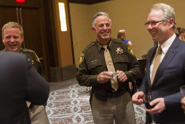 Sheriff Joe Lombardo, center, meets with guests during Metroճ fourth annual Best of the Badge Gala held at Red Rock Resort Spa and Casino in the Summerlin area of Las Vegas on Friday, July 8, 201 ...