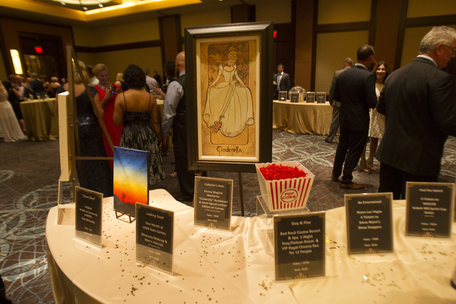 Various items up for auction are seen on display during Metro's fourth annual Best of the Badge Gala held at Red Rock Resort Spa and Casino in the Summerlin area of Las Vegas on Friday, July 8,  ...