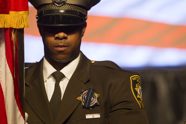 Honor guard member Calvin Wandick, 46, holds the flag during Metro's fourth annual Best of the Badge Gala held at Red Rock Resort Spa and Casino in the Summerlin area of Las Vegas on Friday, Jul ...