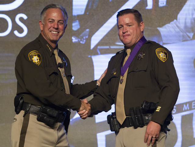 Officer Kyle Hirschi, right, receives the Purple Heart medal from Sheriff Joe Lombardo during Metroճ fourth annual Best of the Badge Gala held at Red Rock Resort Spa and Casino in the Summerlin a ...