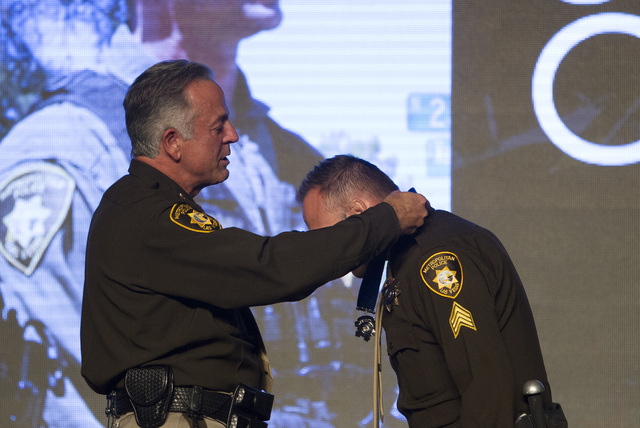 Sergeant David Callen, right, receives the Medal of Honor from Sheriff Joe Lombardo during Metroճ fourth annual Best of the Badge Gala held at Red Rock Resort Spa and Casino in the Summerlin area ...