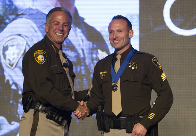 Sergeant David Callen, right, receives the Medal of Honor from Sheriff Joe Lombardo during Metroճ fourth annual Best of the Badge Gala held at Red Rock Resort Spa and Casino in the Summerlin ...