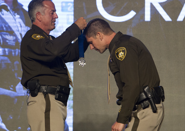 Officer Paul Lourenco, right, receives the Medal of Honor from Sheriff Joe Lombardo during Metroճ fourth annual Best of the Badge Gala held at Red Rock Resort Spa and Casino in the Summerlin area ...