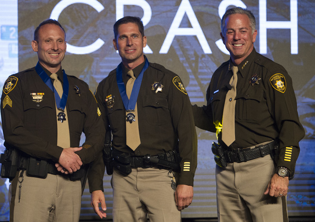 Sheriff Joe Lombardo, right, poses for a photo with Sergeant David Callen, left, and Officer Paul Lourenco, center, after awarding them with the Medal of Honor during Metroճ fourth annual Best of ...