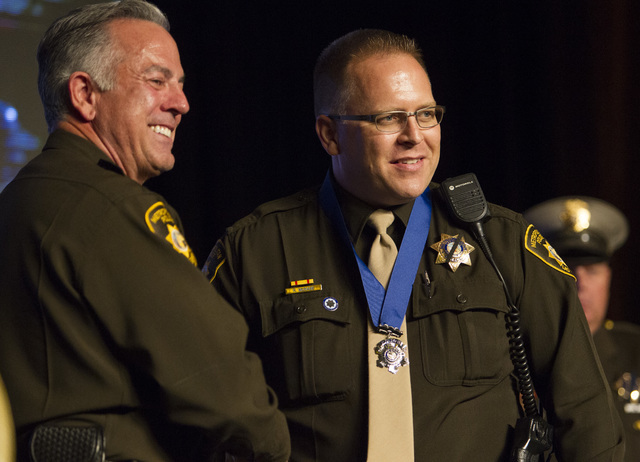 Officer Ryan McNabb, right, receives the Medal of Honor from Sheriff Joe Lombardo during Metroճ fourth annual Best of the Badge Gala held at Red Rock Resort Spa and Casino in the Summerlin area o ...
