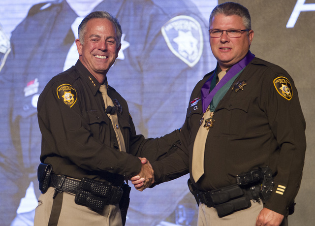 Officer Thomas Clevenger, right, poses with Sheriff Joe Lombardo after receiving the Medal of Valor and Purple Heart medal during Metroճ fourth annual Best of the Badge Gala held at Red Rock Reso ...