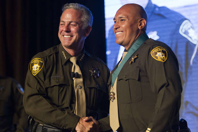 Officer Sergio Orizabal, right, receives the Medal of Valor from Sheriff Joe Lombardo during Metroճ fourth annual Best of the Badge Gala held at Red Rock Resort Spa and Casino in the Summerlin ar ...