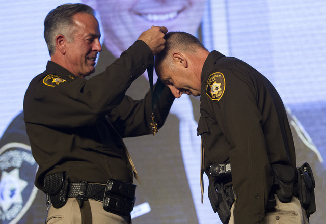 Officer Greg Sedminik, right, receives the Purple Heart medal from Sheriff Joe Lombardo during Metro's fourth annual Best of the Badge Gala held at Red Rock Resort Spa and Casino in the Summerli ...