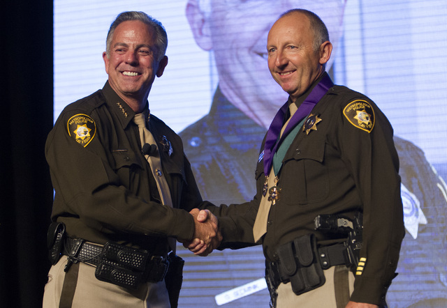 Officer Greg Sedminik, right, receives the Purple Heart medal and Medal of Valor from Sheriff Joe Lombardo during Metro's fourth annual Best of the Badge Gala held at Red Rock Resort Spa and Cas ...