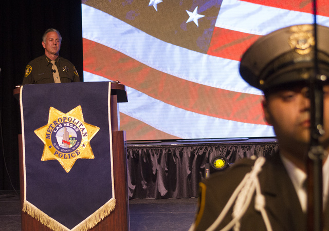 Sheriff Joe Lombardo, left, looks on as he stands on stage during Metro's fourth annual Best of the Badge Gala held at Red Rock Resort Spa and Casino in the Summerlin area of Las Vegas on Friday ...