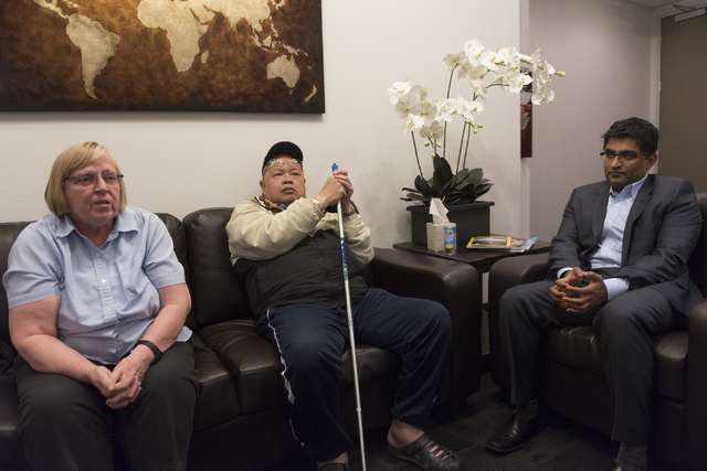 Alzheimer's patient Jay Casero, center, his wife, Dixie Casero and Dr. Bharat Mocherla speak with a reporter about the Mindset study at Dr. Bharat Mocherla's office in Las Vegas Thursday, May 26,  ...