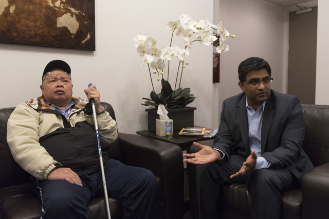 Dr. Bharat Mocherla, right, speaks with a reporter about  the Mindset study at Dr. Mocherla's office in Las Vegas Thursday, May 26, 2016. Alzheimer's patient Jay Casero listens. The Mindset study  ...