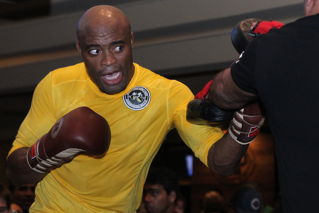 Anderson Silva, left, works out during a promotional event for UFC 183 at MGM Grand casino-hotel Wednesday, Jan. 28, 2015. Silva is scheduled to fight Nick Diaz Saturday at the MGM Garden Arena. ( ...