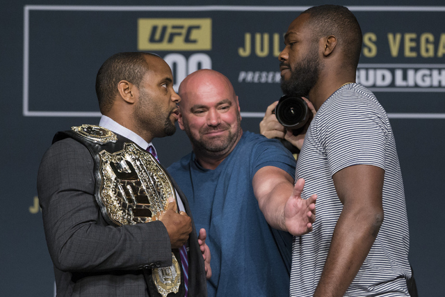 UFC president Dana White, center, watches Daniel Cormier, left, and Jon Jones pose during the UFC 200 press conference at MGM Grand hotel-casino on Tuesday, July 5, 2016, in Las Vegas. (Erik Verdu ...